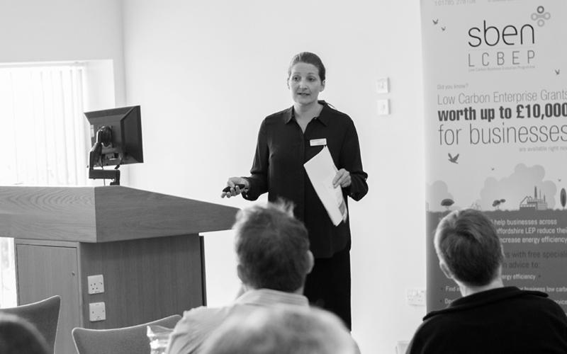 A woman giving a presentation
